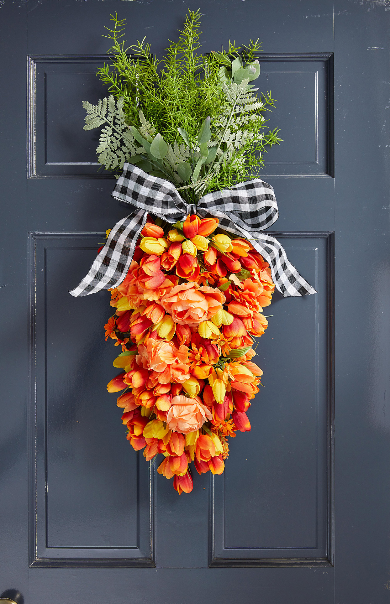 carrot wreath hanging on black door