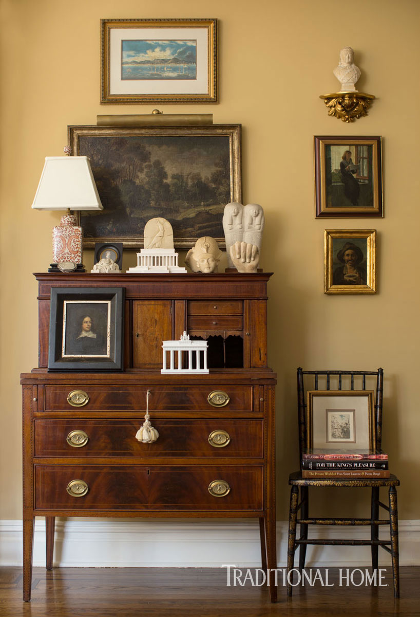 classic wooden dresser against gold wall