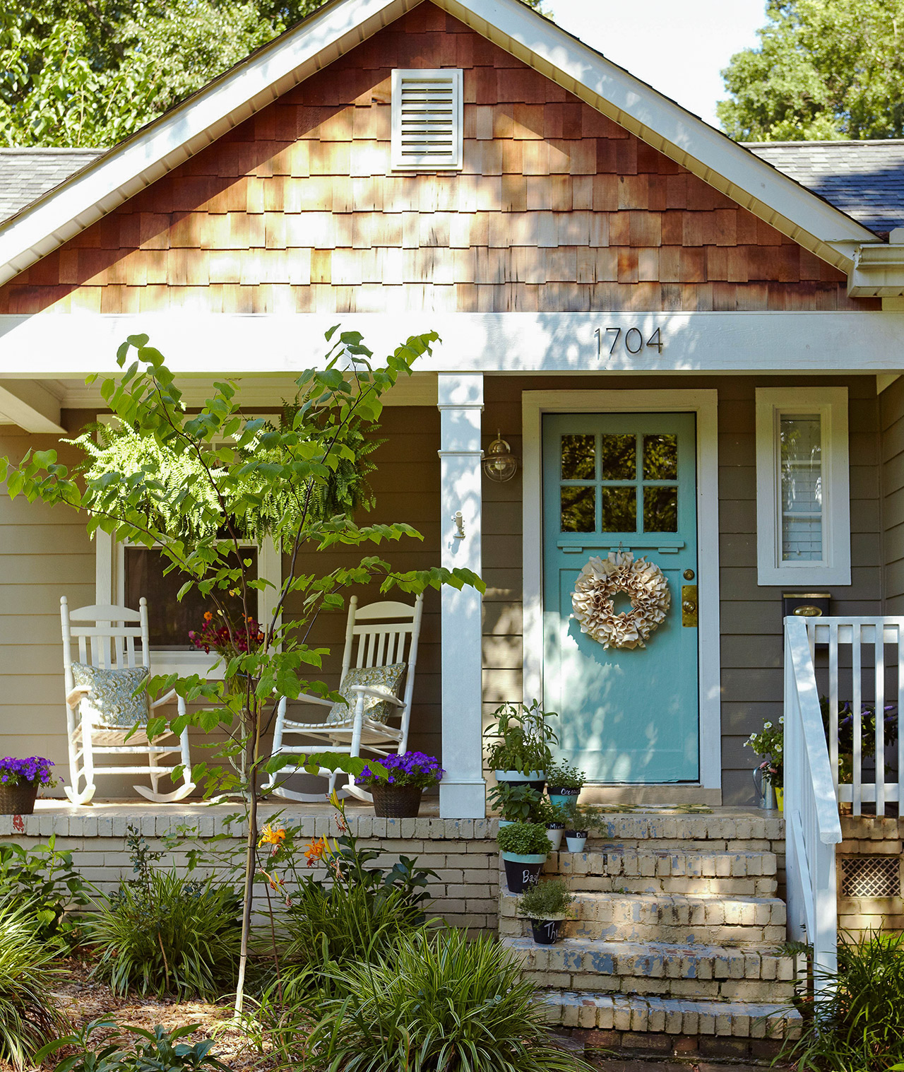 cottage style home front porch blue door