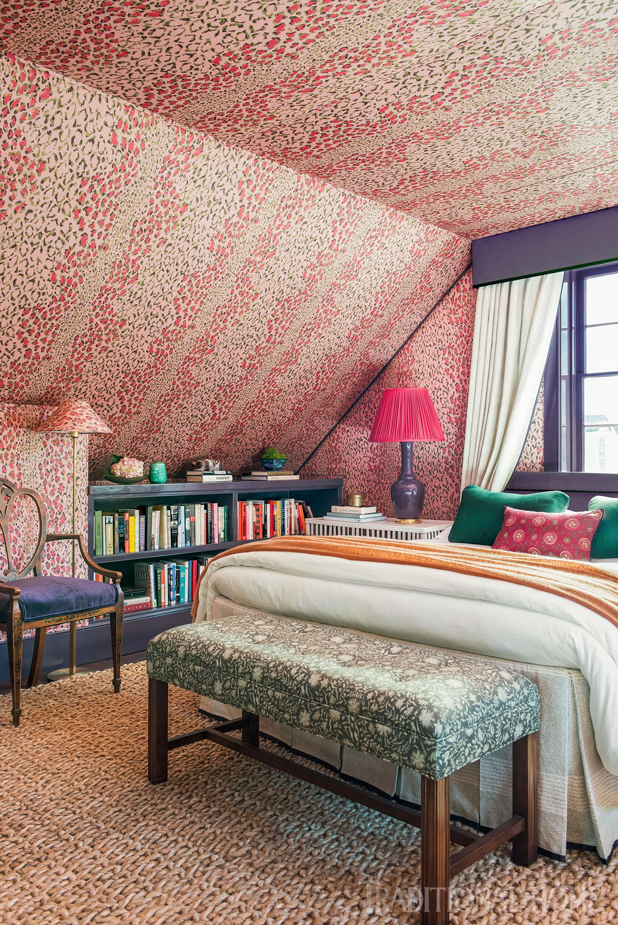 dormer bedroom with pink leopard print walls and ceiling