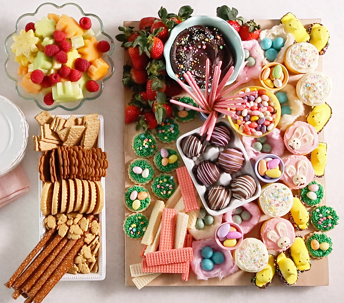 Easter Dessert Board with fruit, cookies, cupcakes and cookies
