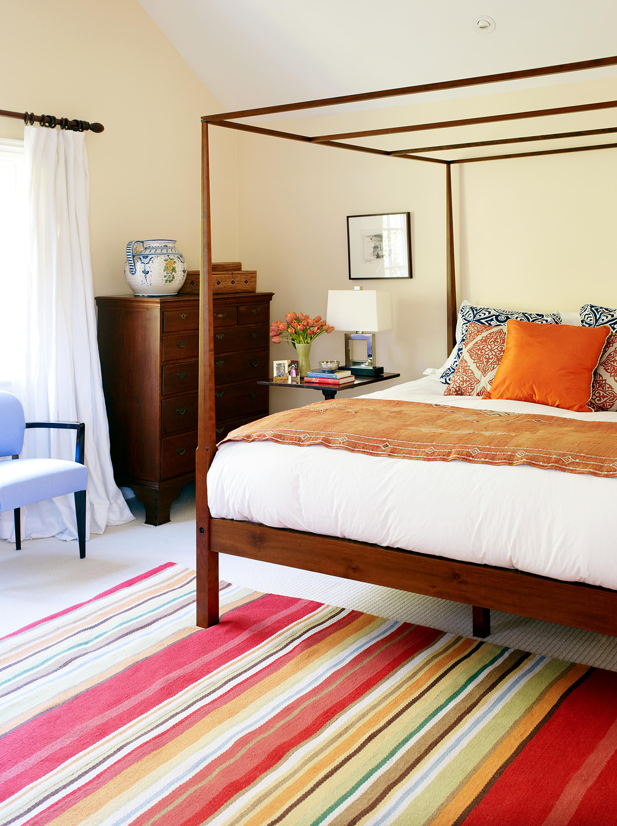 Fading Sun Yellow + Flame Orange bedroom with striped rug