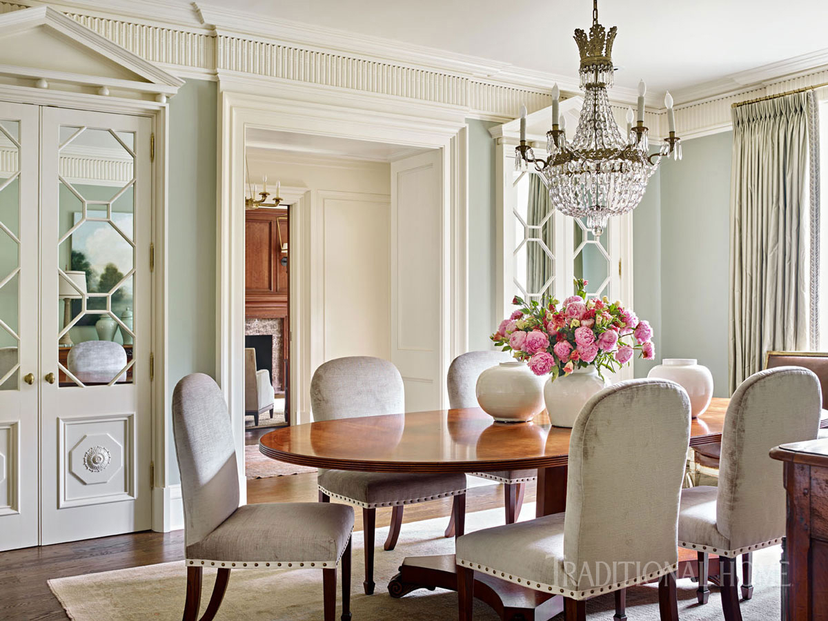 formal dining room with cushioned chairs