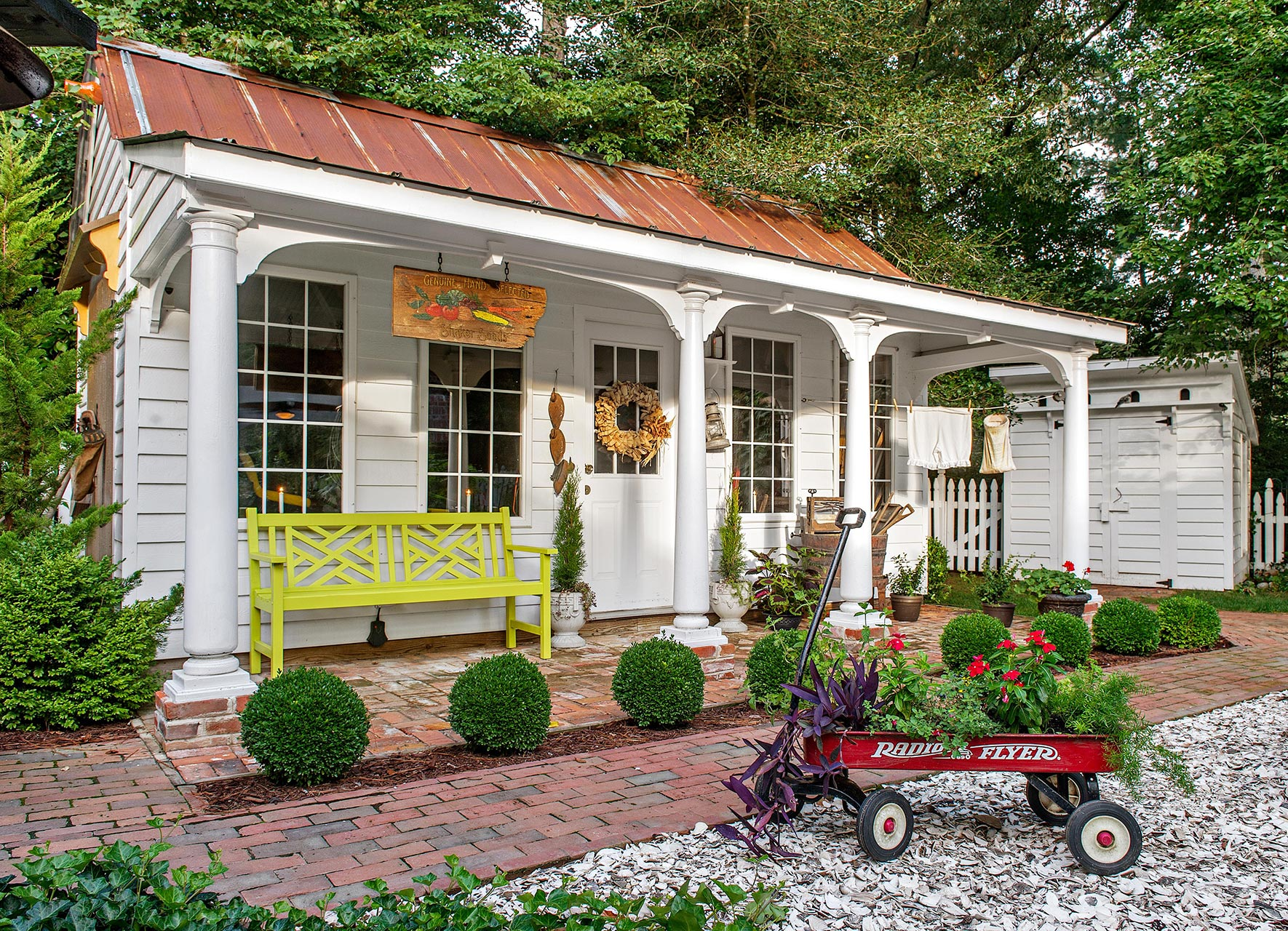 formal garden shed with porch and colonnade