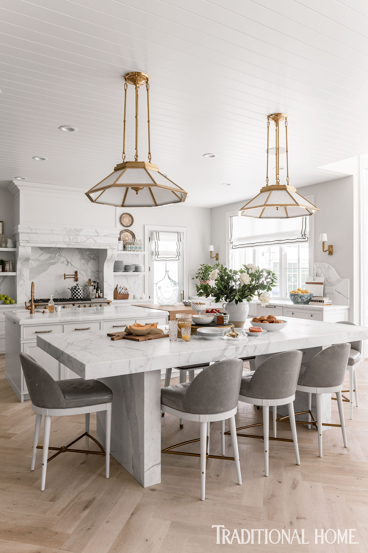 formal white kitchen with huge table