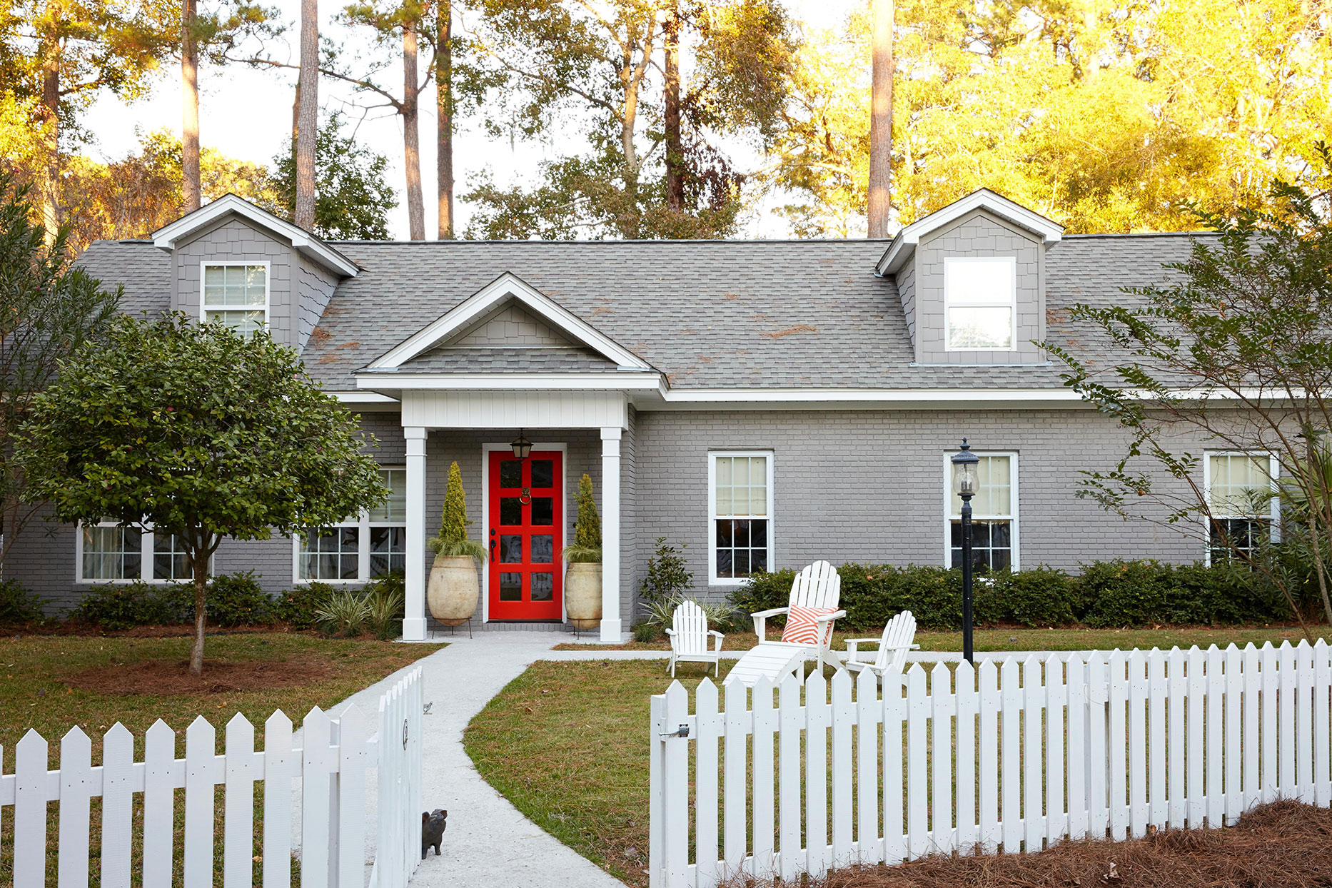 gray house with bright red door