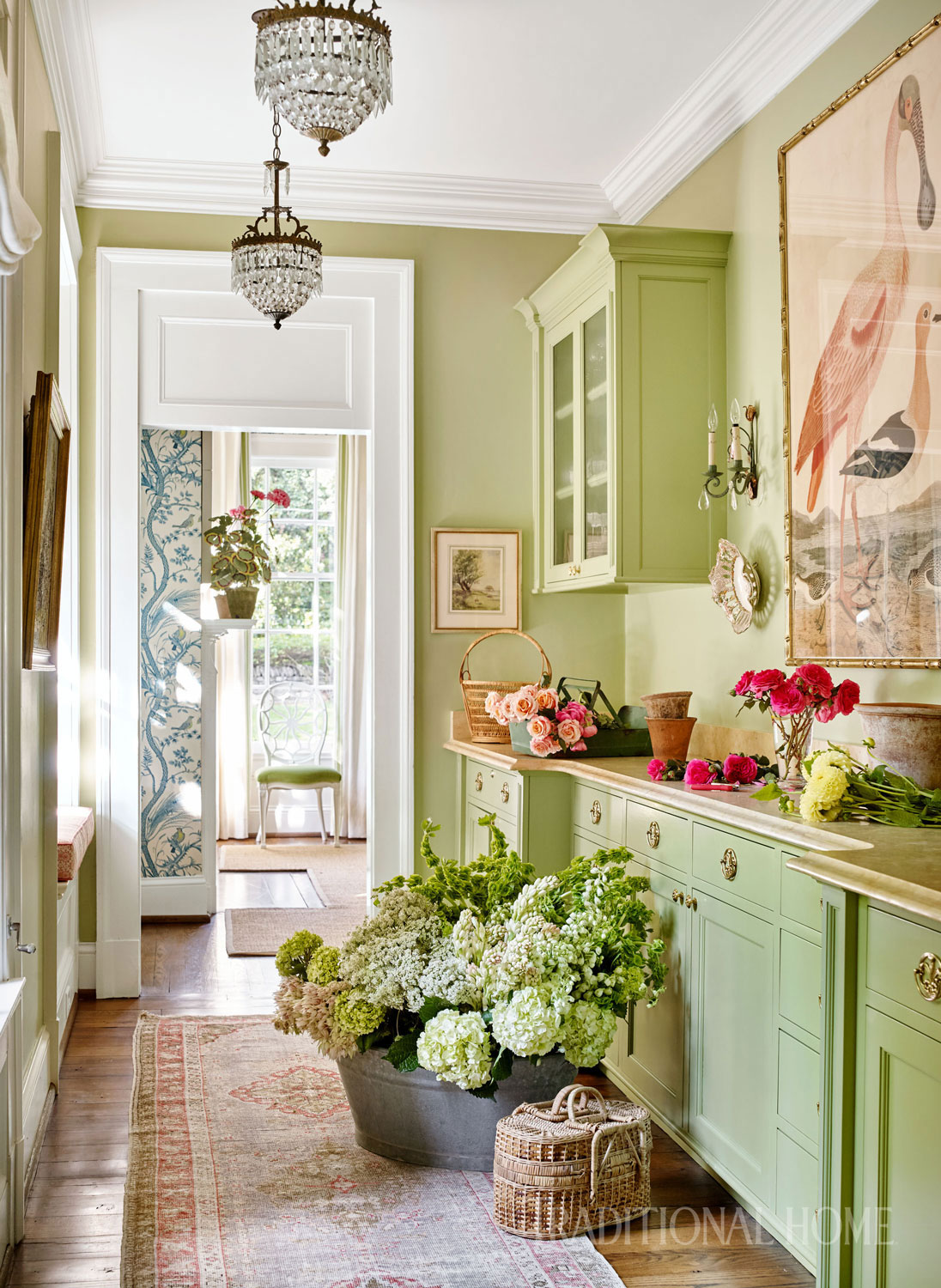 green flower arranging space with white trim