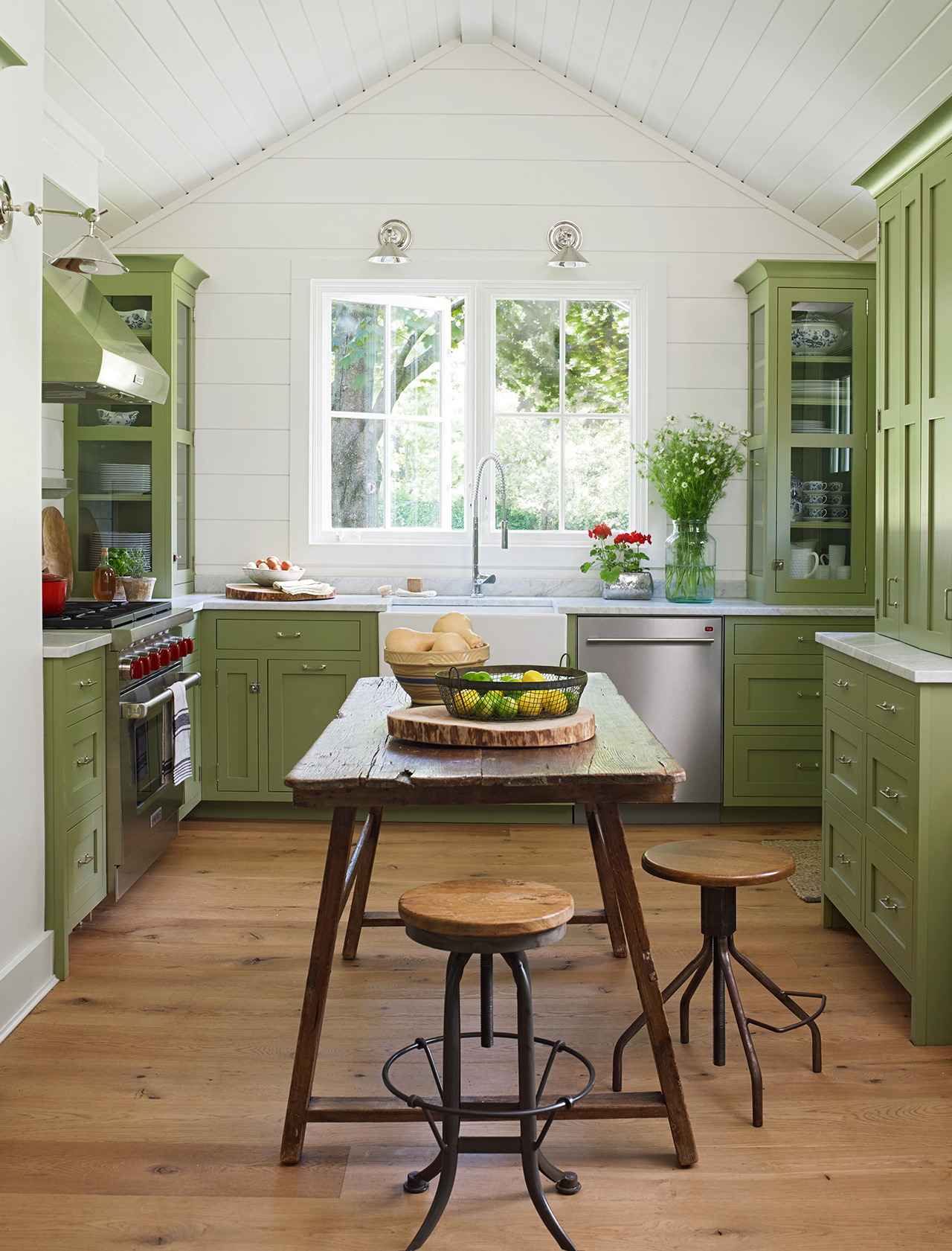 green wood kitchen with pitched shiplap ceiling