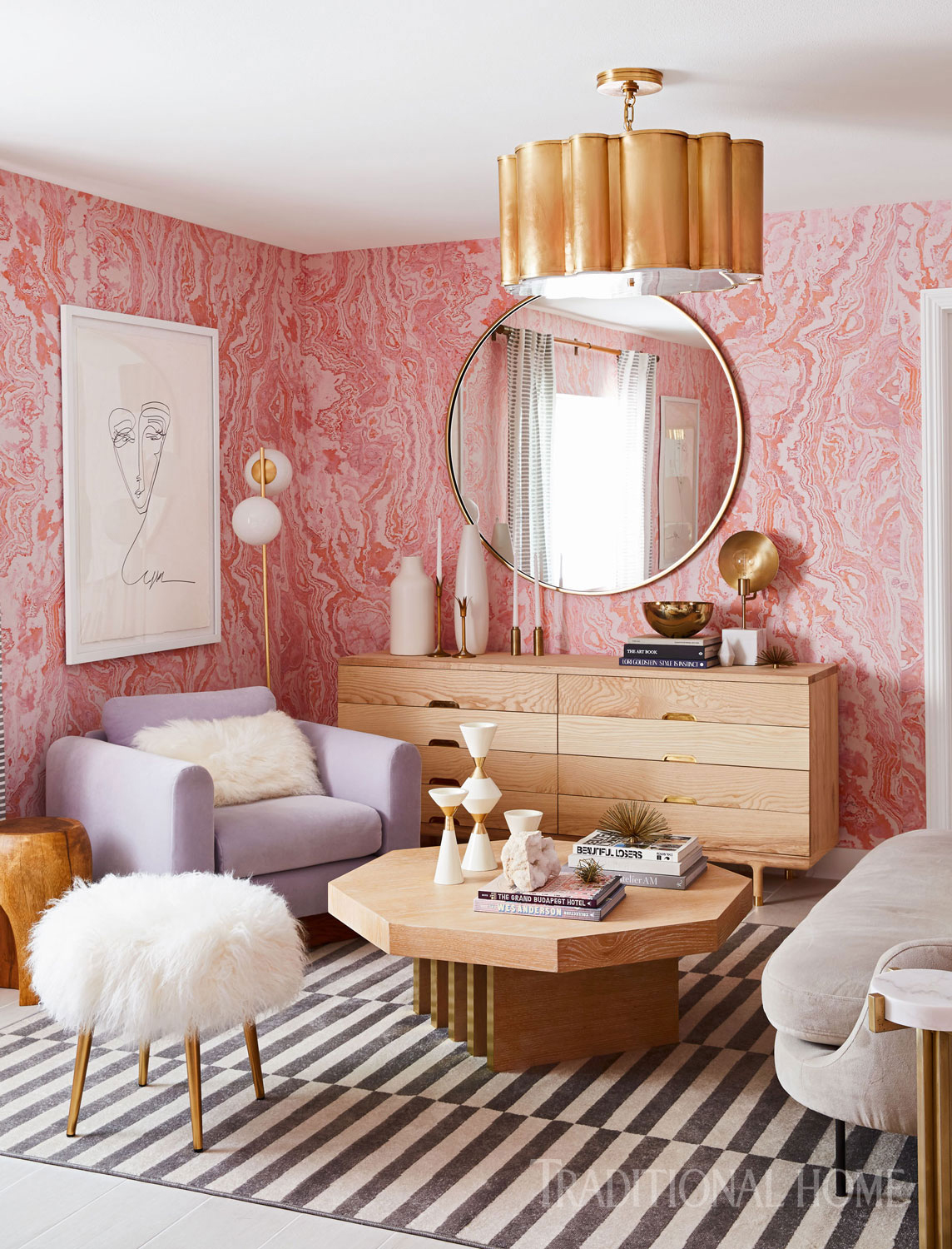 guest room with pink wallpaper and striped rug