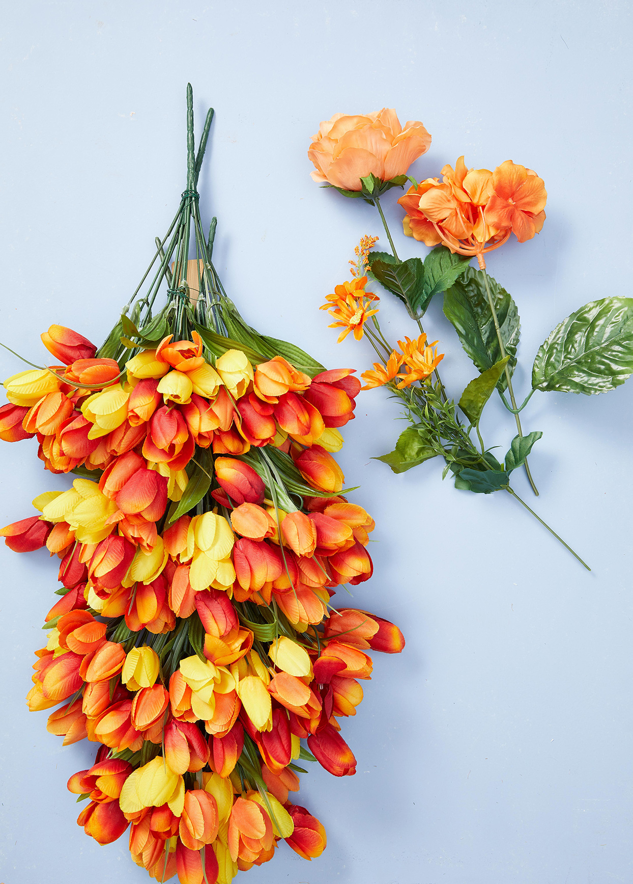 hanging bouquet of tulips and other orange flowers