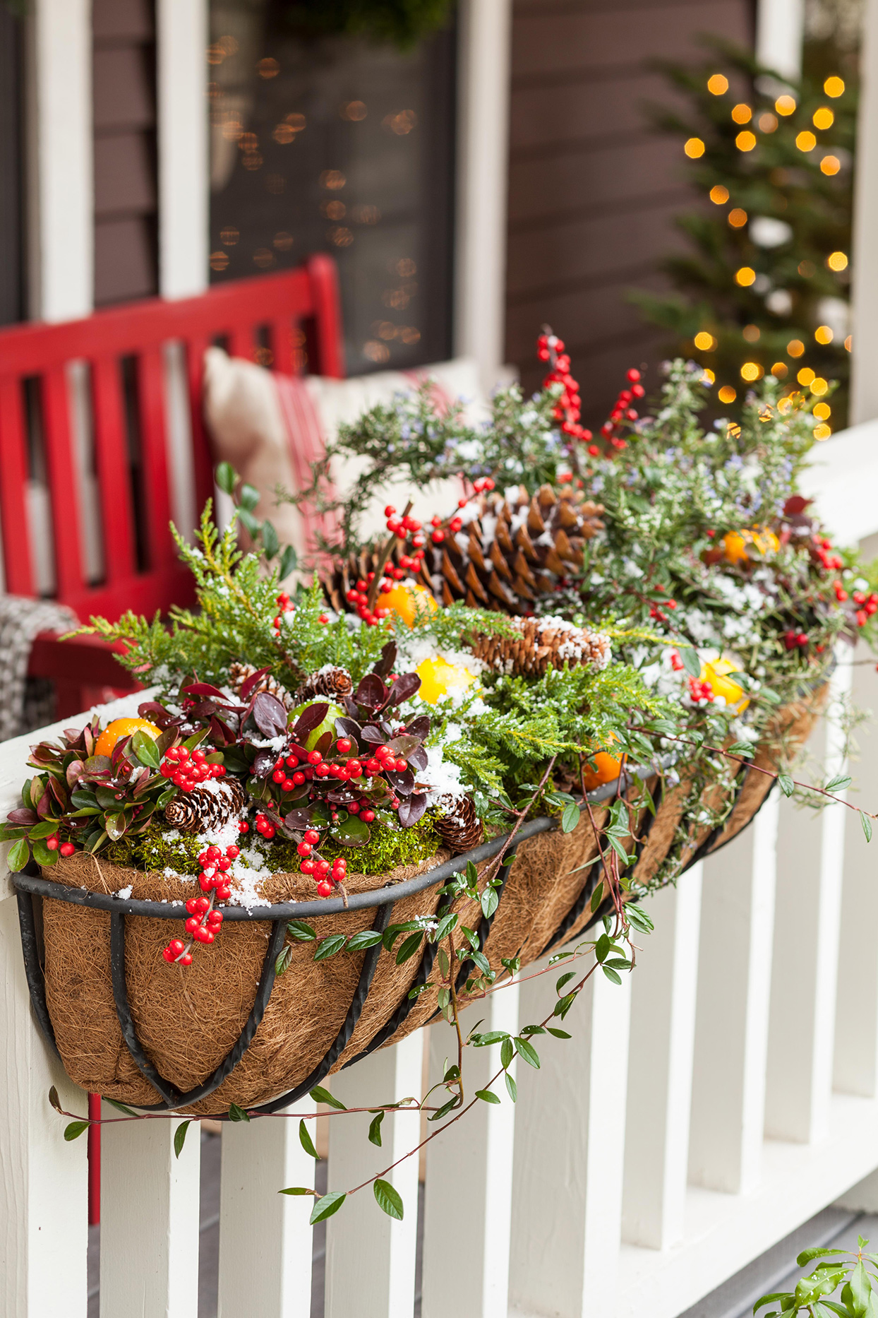 holiday décor accent box on white porch railing