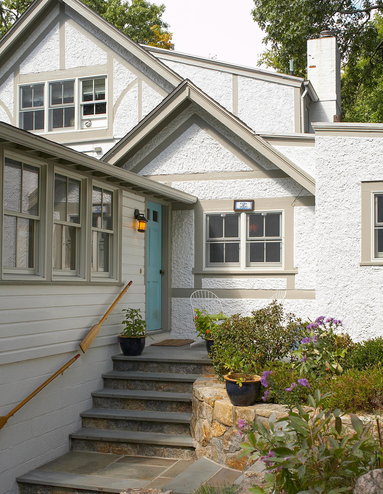 home exterior with stucco siding blue front door