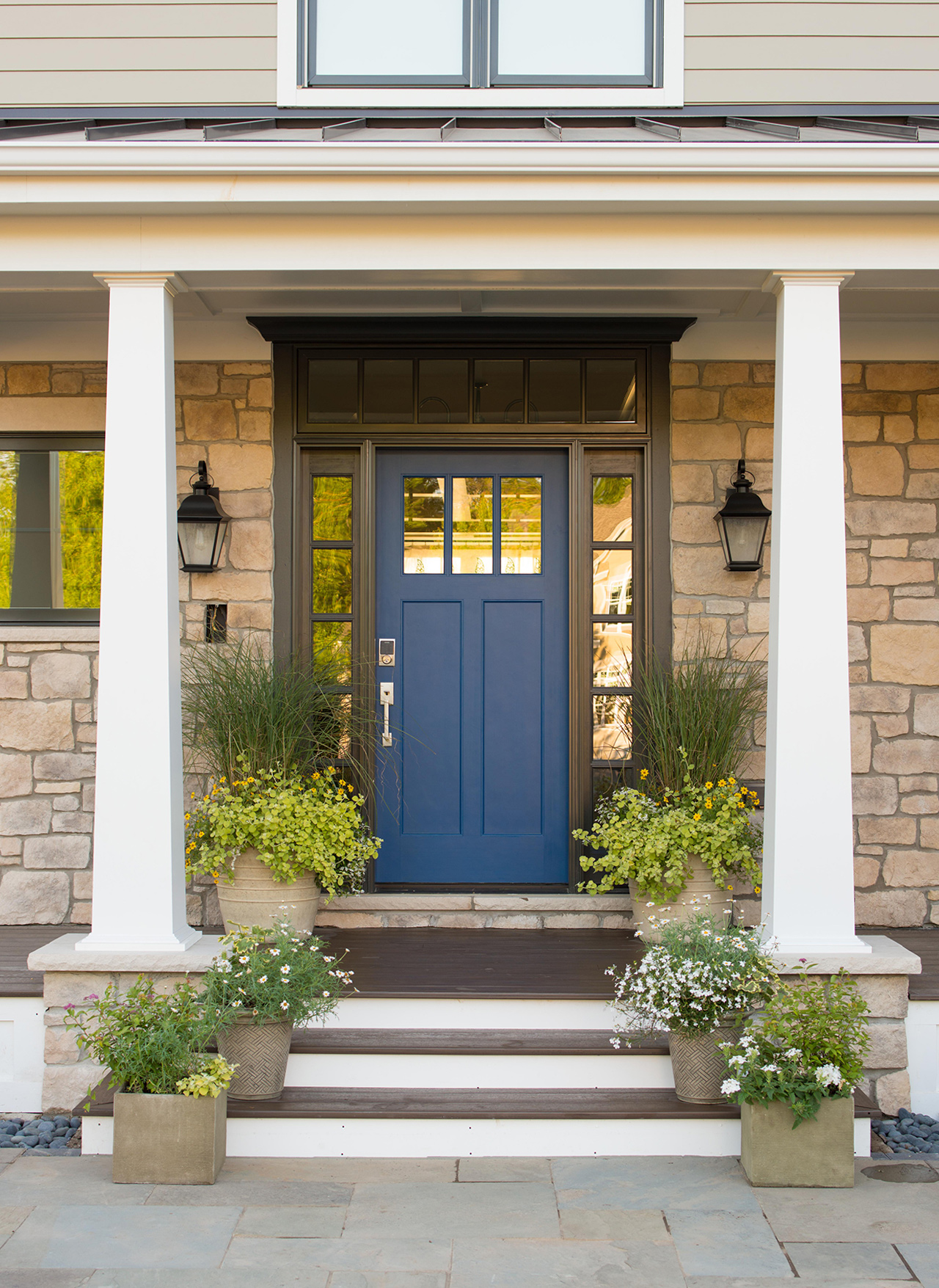 exterior front porch steps to navy blue door