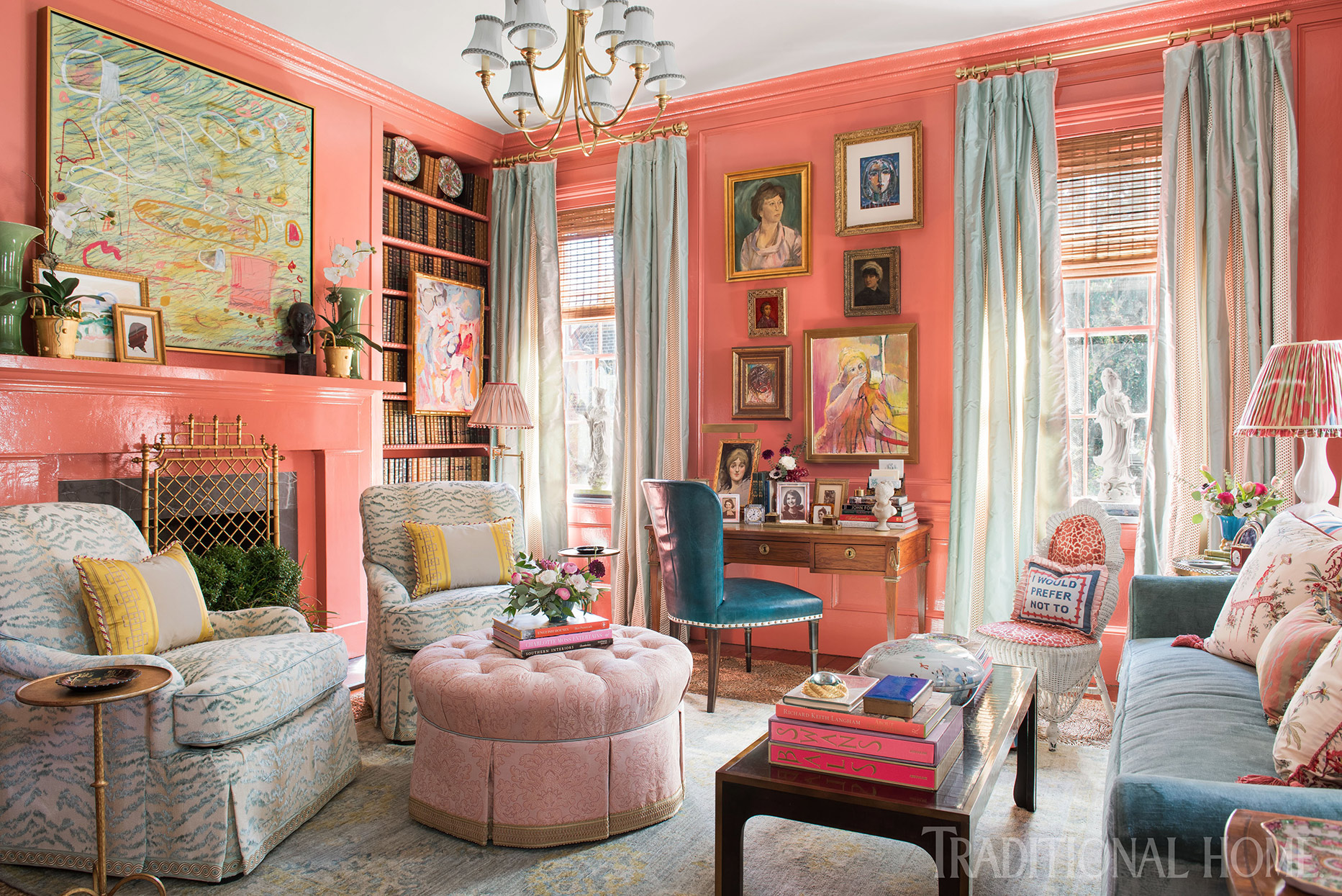 bright ladies lounge with coral walls and bold accents
