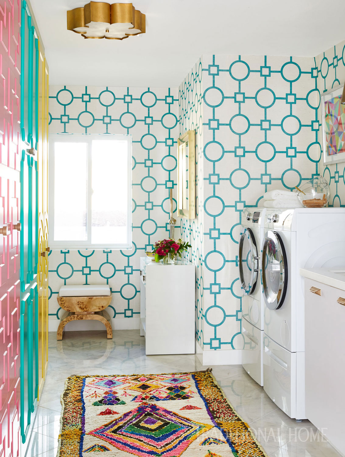 laundry room with colorful cabinets
