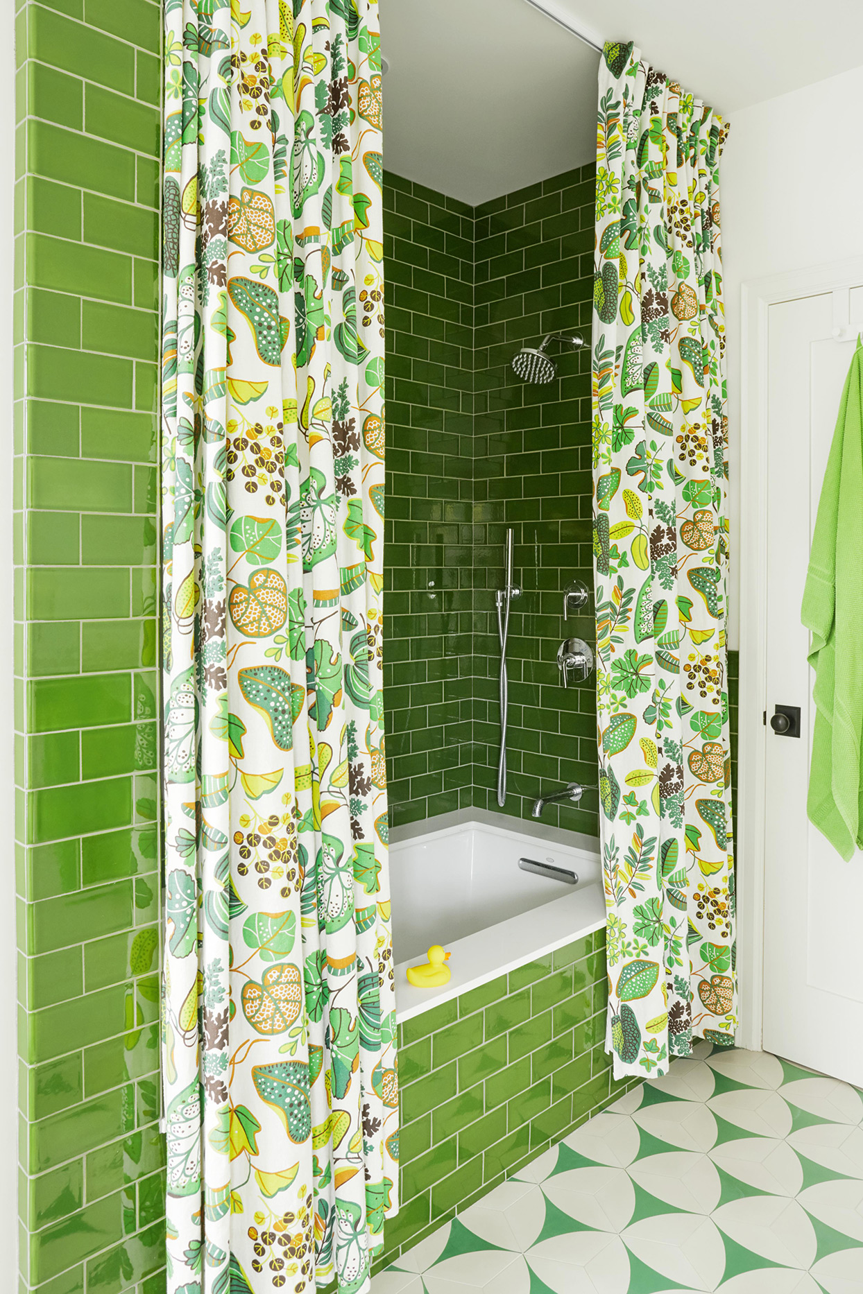lime green bathroom with colorful shower curtain