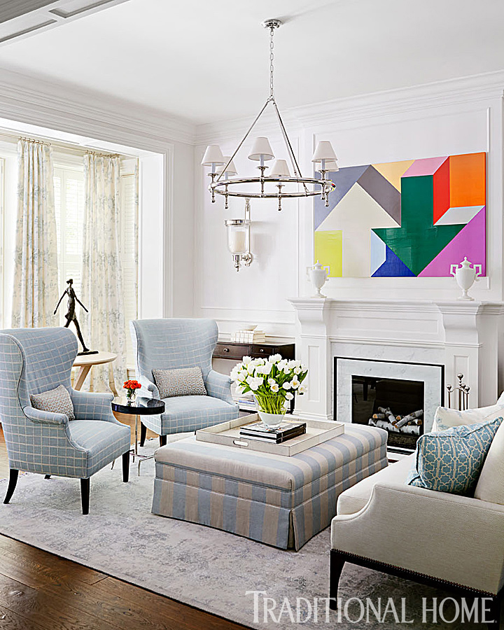 living room with blue chairs and fireplace