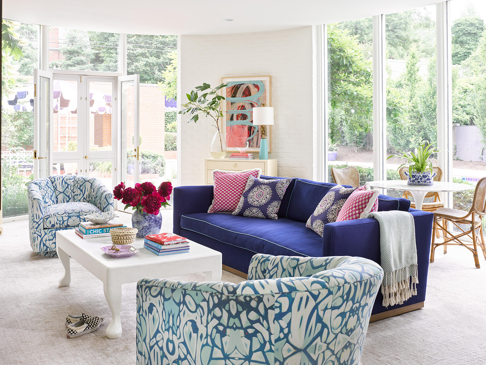 Living room with graphic chairs and blue sofa