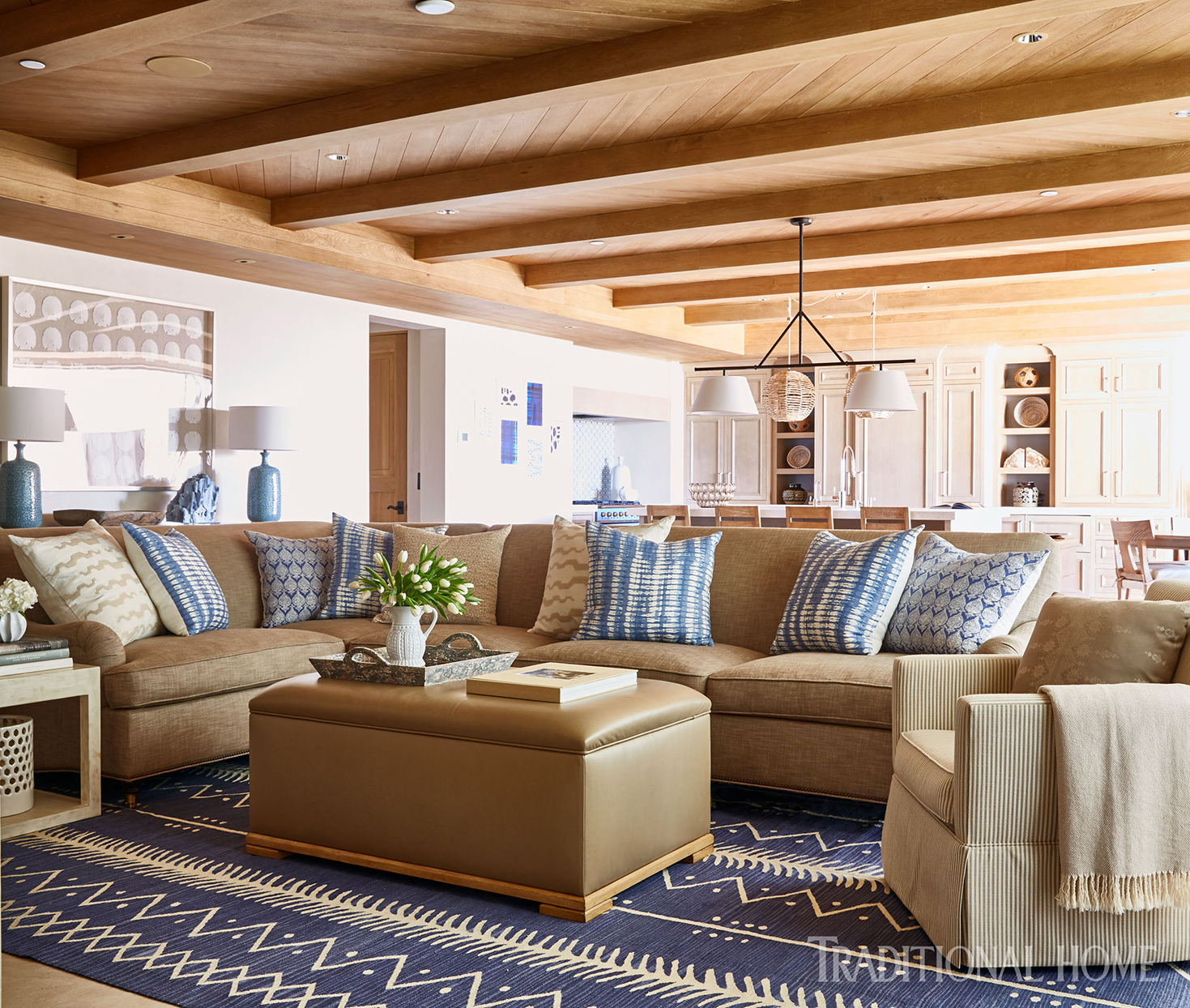 Living room with wooden ceiling and textured rug