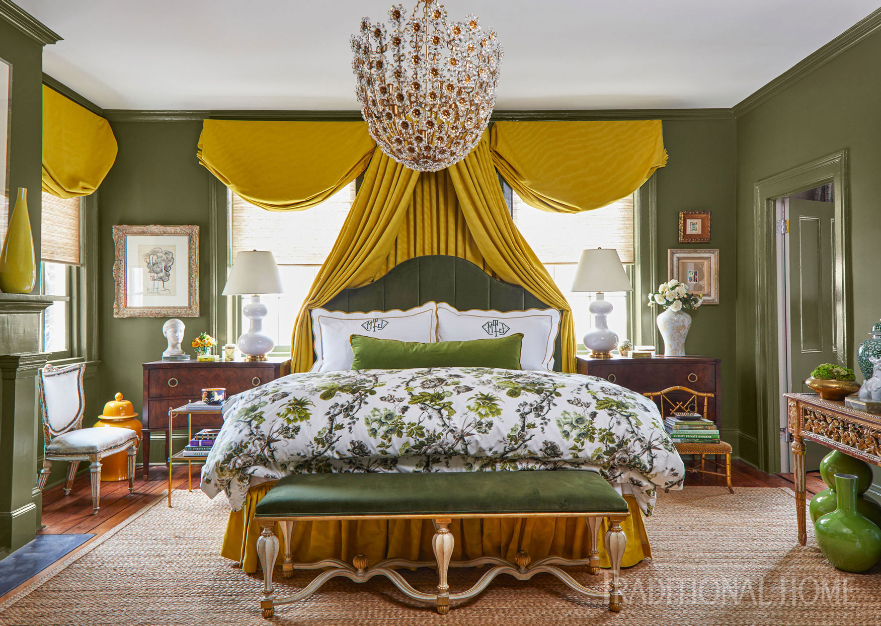 master bedroom with bed and chandelier