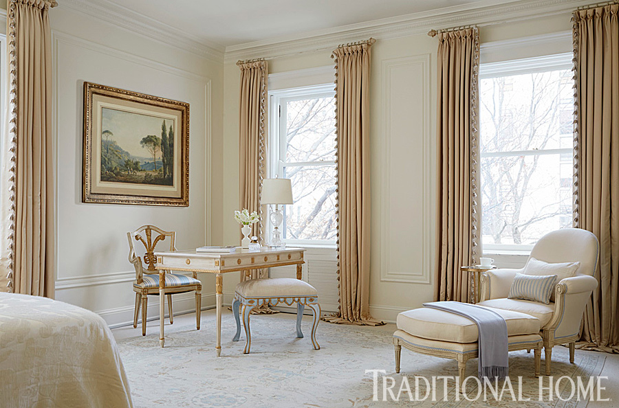 master bedroom sitting area in gold, cream and blue