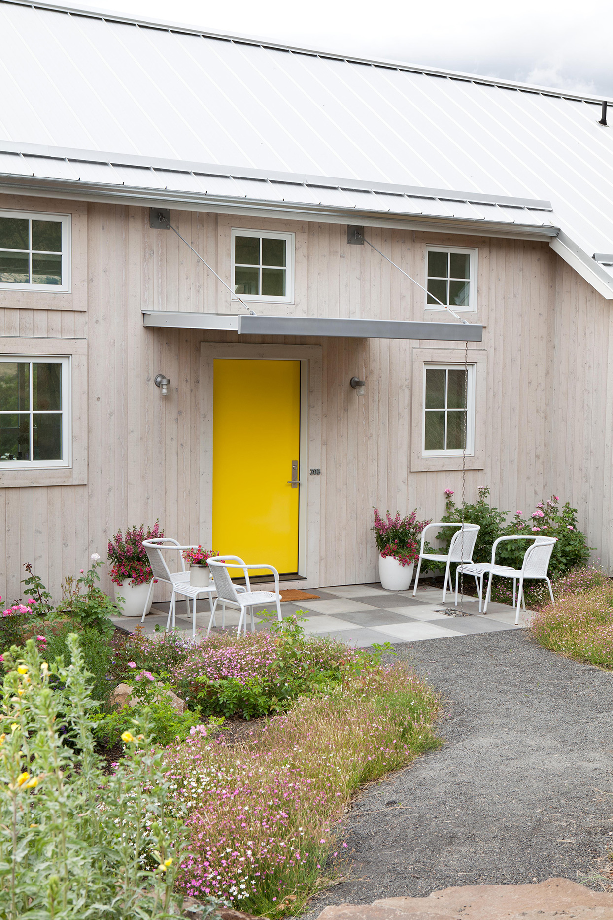 Modern style exterior with yellow door