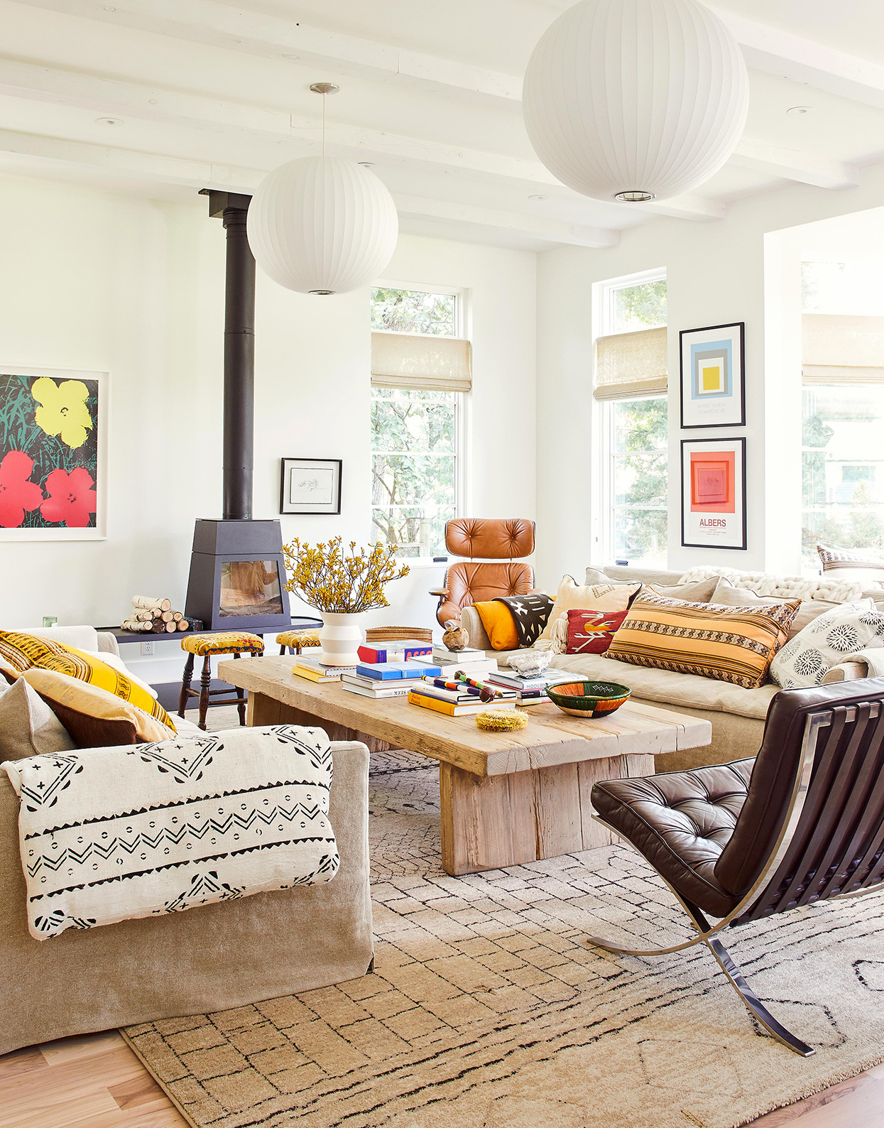 neutral colors in living room with moroccan fabrics and pop art