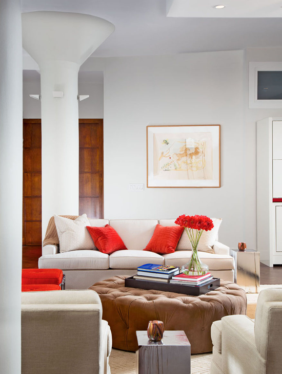 neutral tones living room with red accent pillows