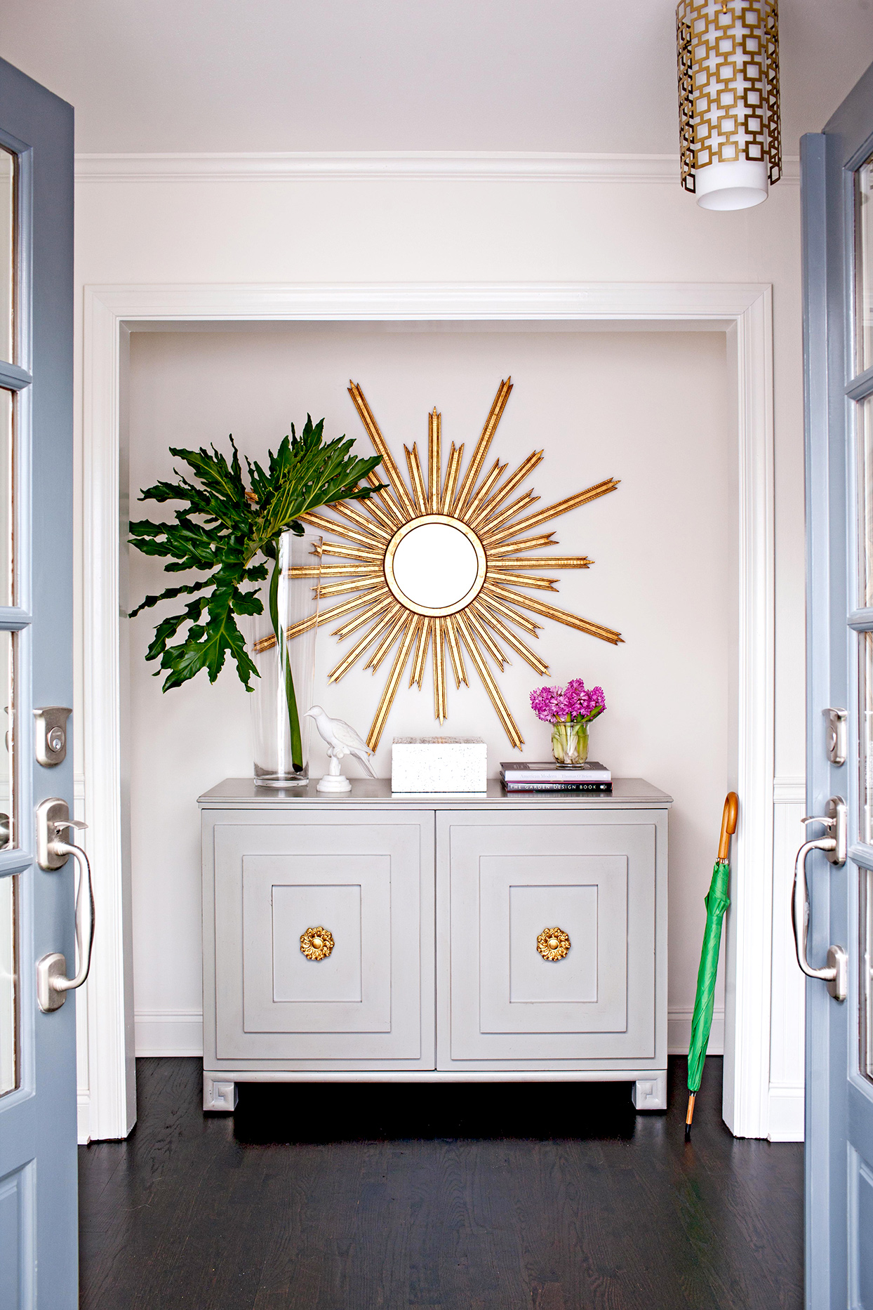 Nook with gray cabinet and decorative mirror