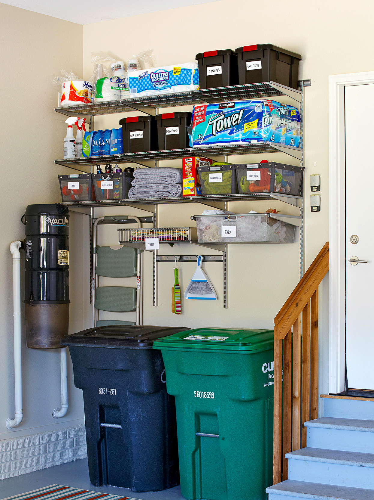 organized garage corner with built-in hooks and shelving
