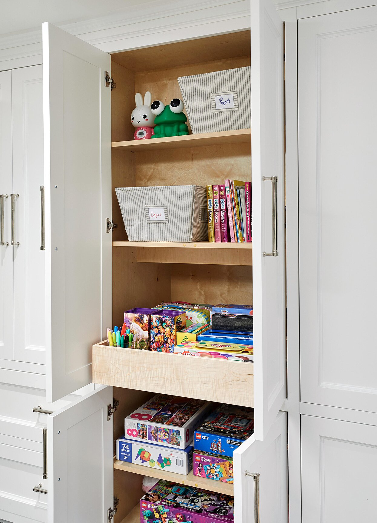 games and toys in cabinets and pull-out shelf