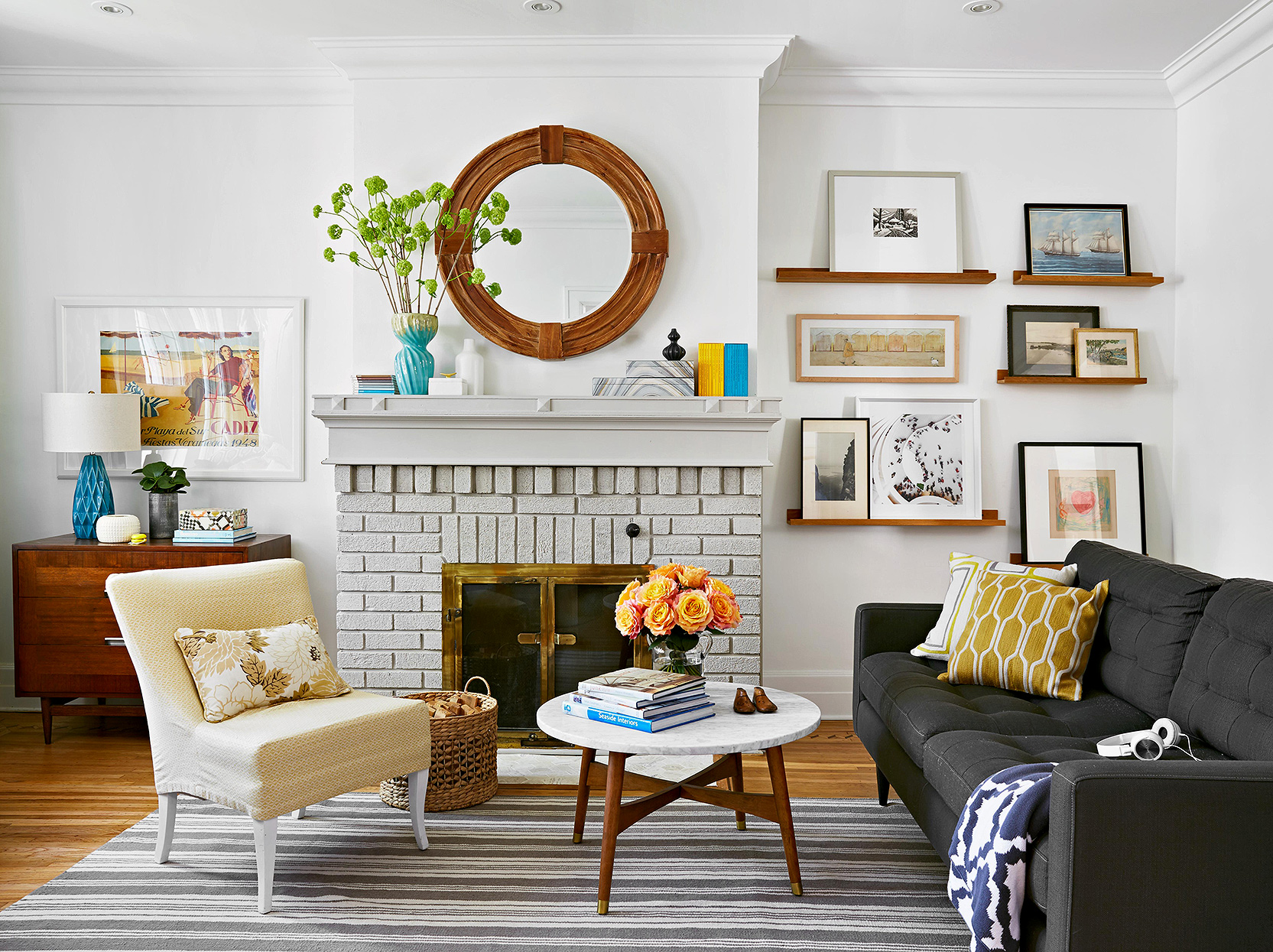 modern white living room with gray painted brick fireplace