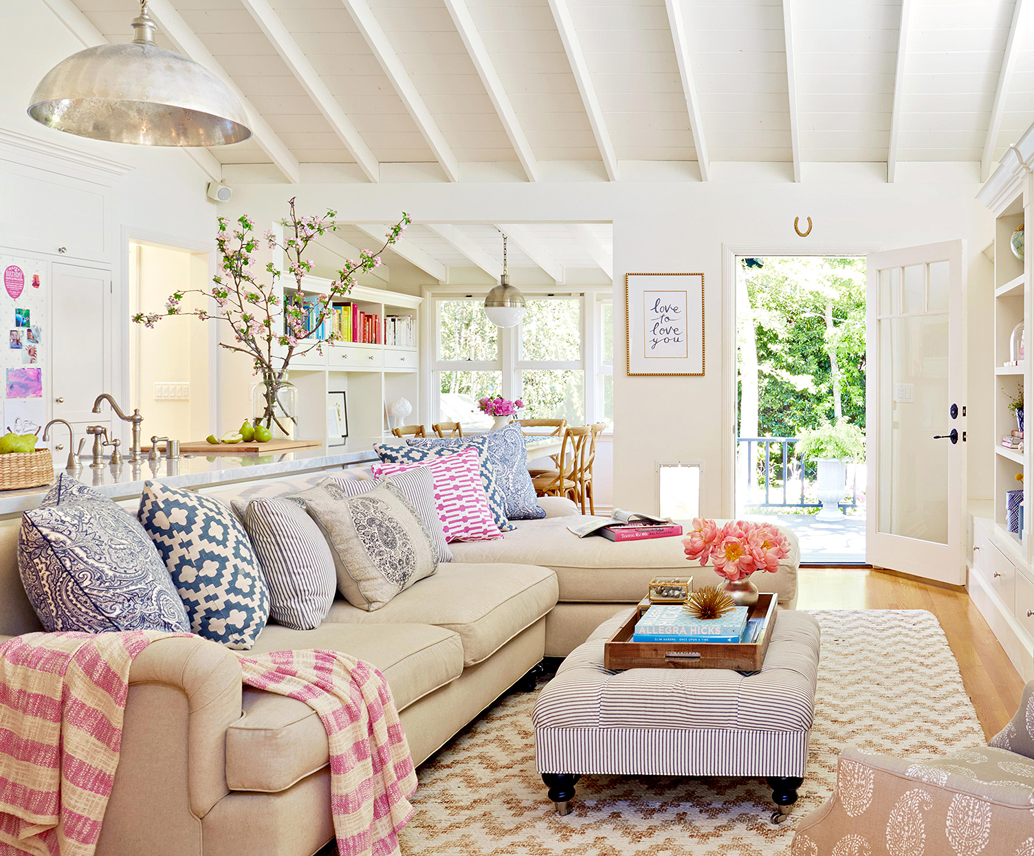 pink-and-blue themed open-concept living room and kitchen