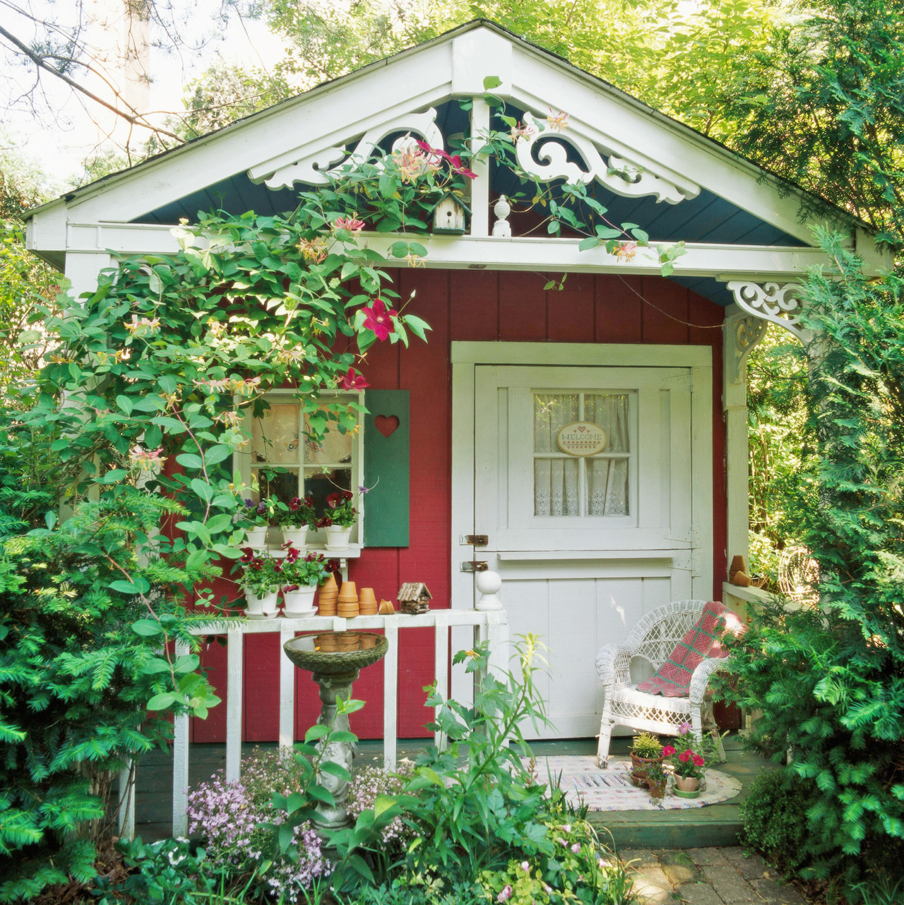 red garden shed with white trim