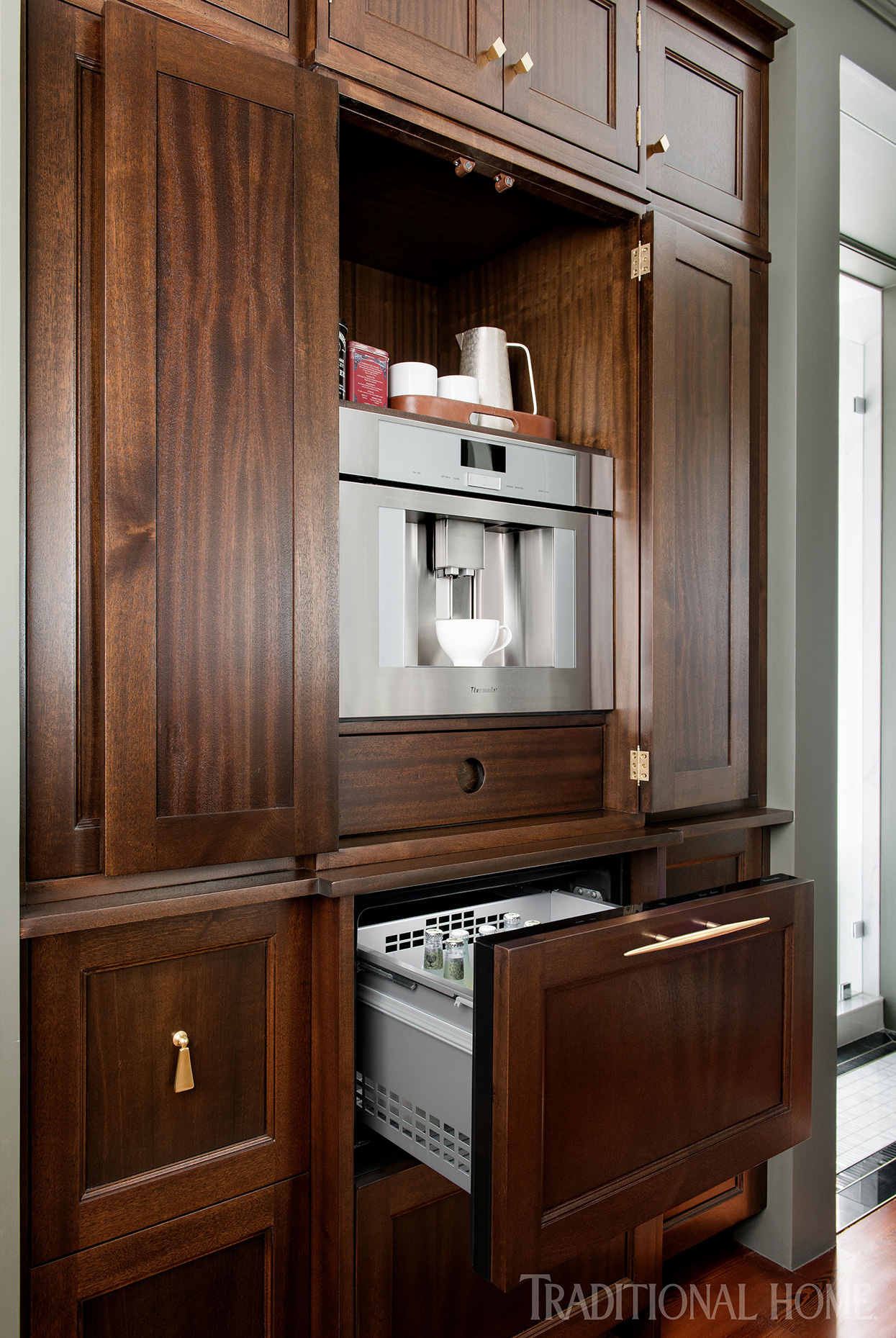 rich wood cabinetry with built-in beverage station