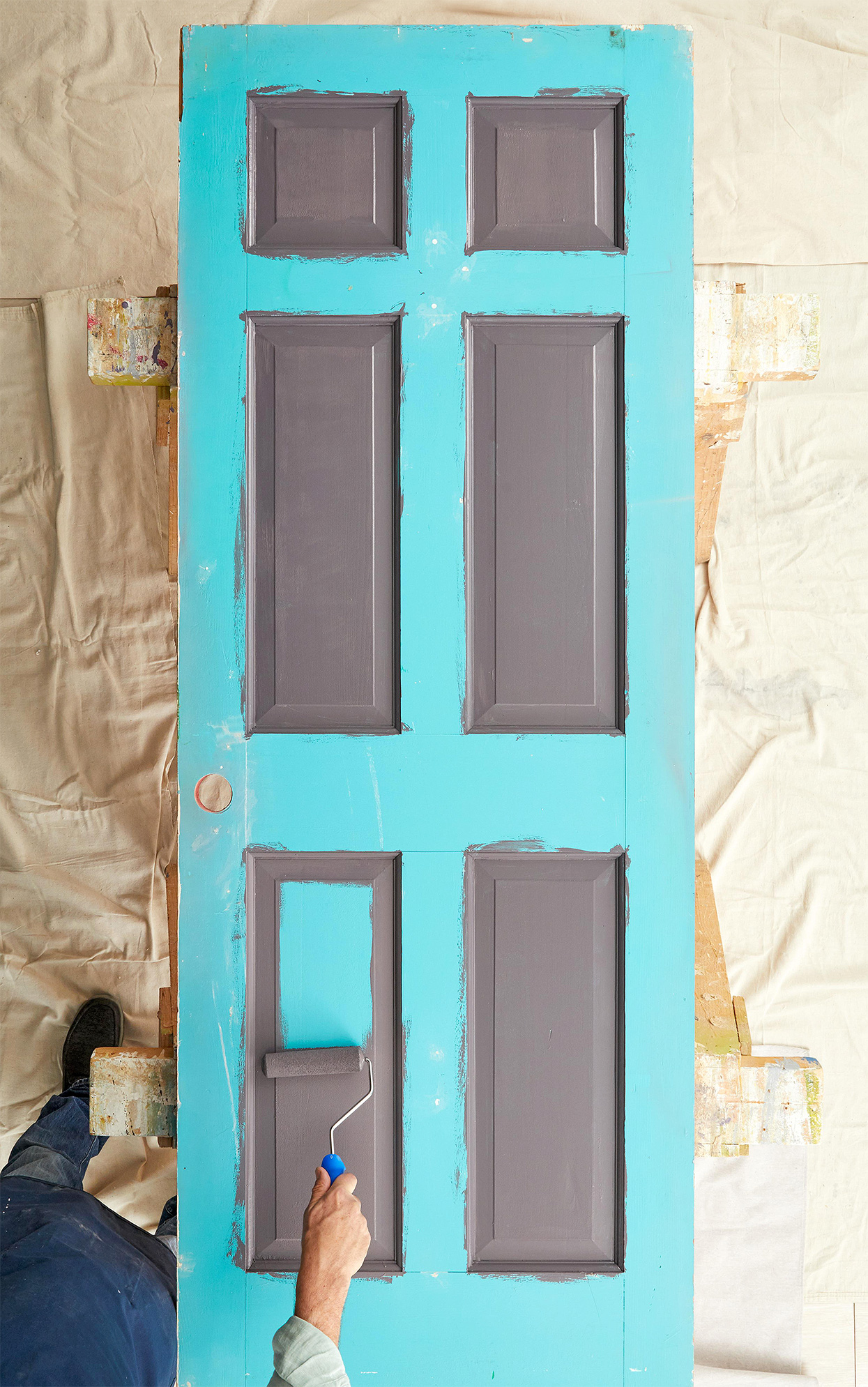 rolling paint onto beveled panels on door face