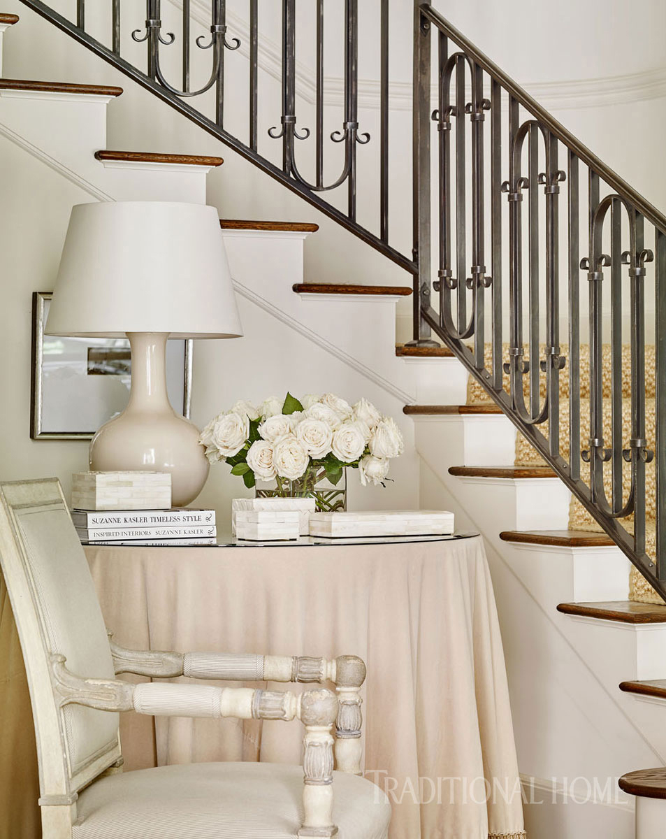 skirted table next to grand staircase