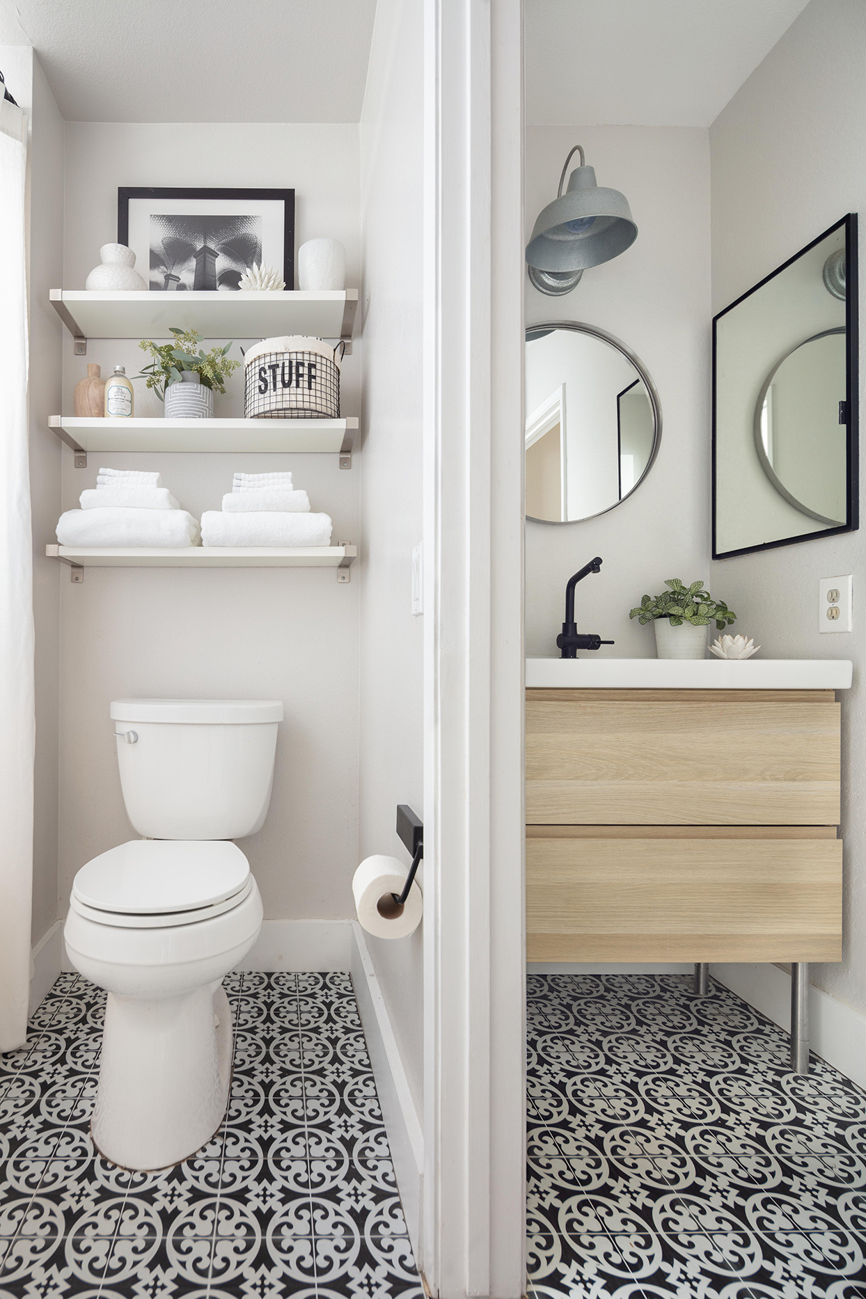 small bathroom with black and white tiled floor