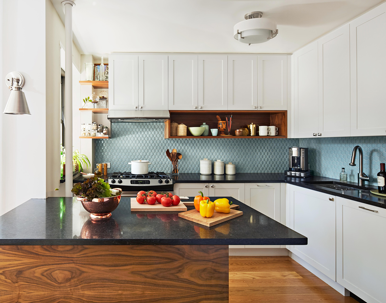 small kitchen with black-countered island