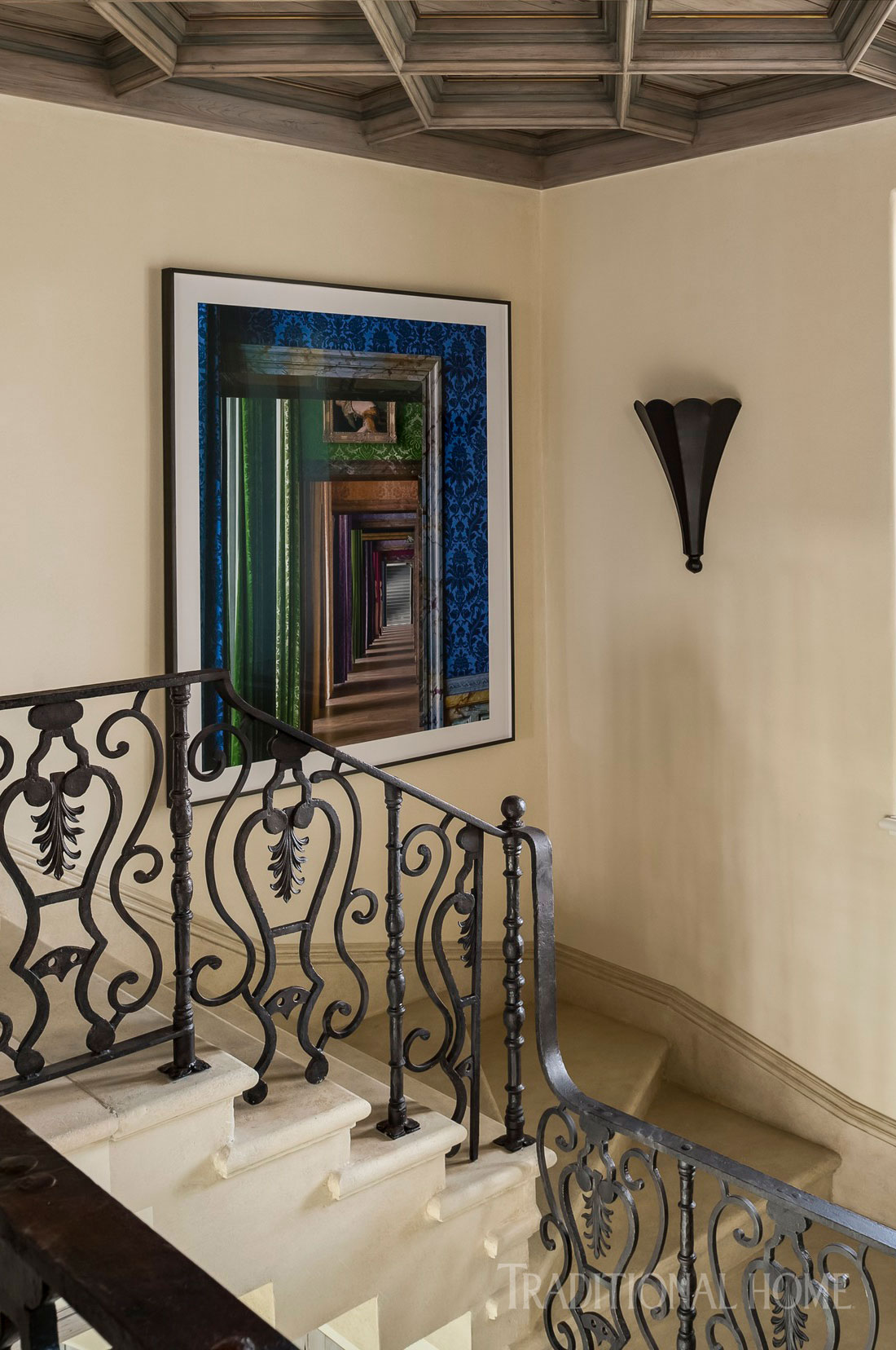 stairway with scallop sconced railing and framed photograph