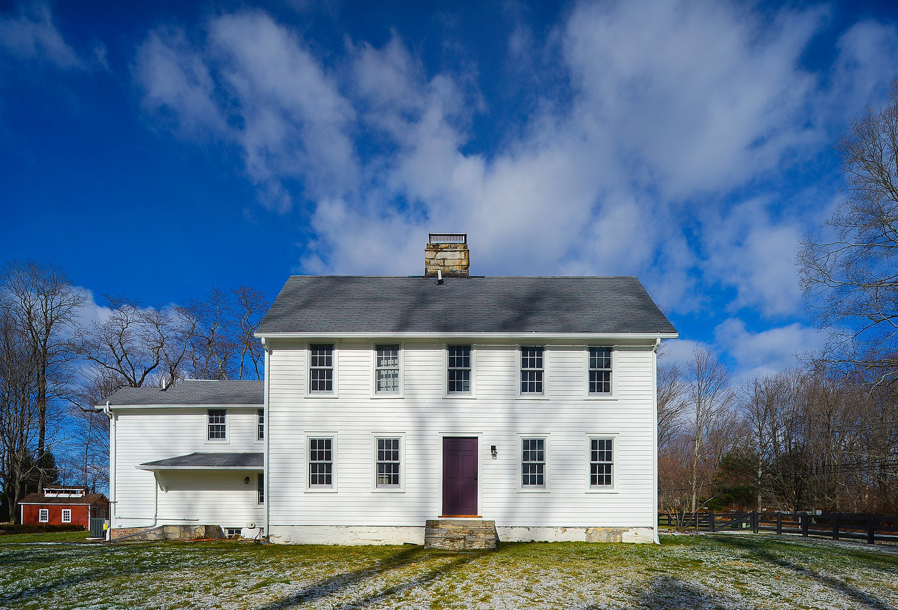 bright blue sky above saltbox house