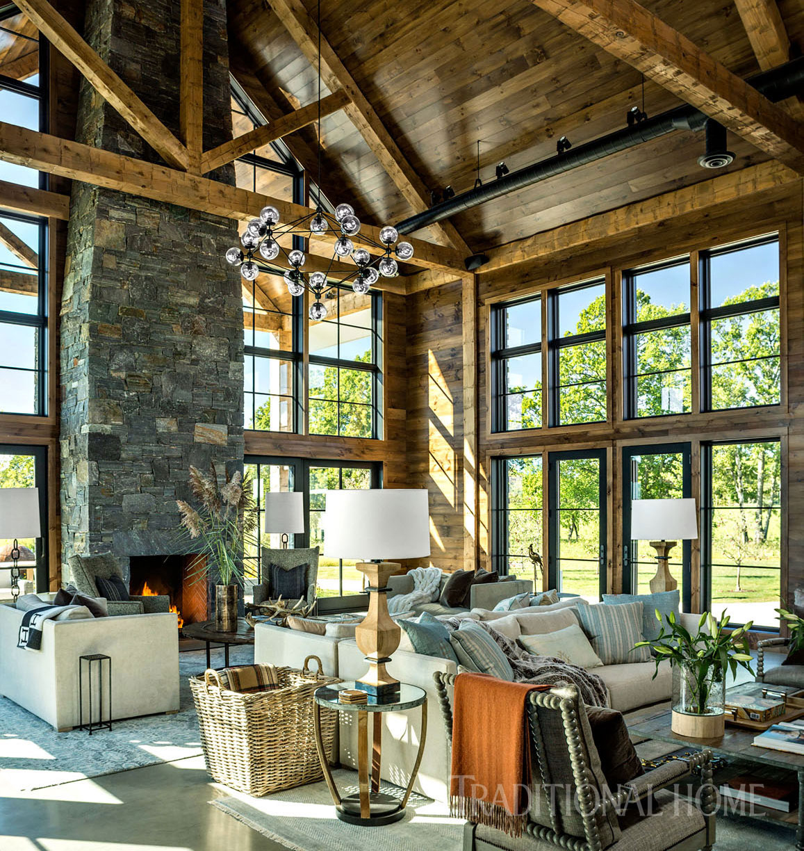 stone fireplace and wood ceiling beams