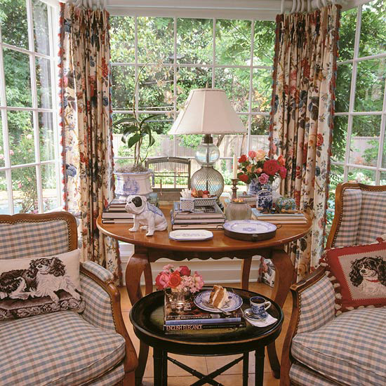 sun room with chairs and dog decor