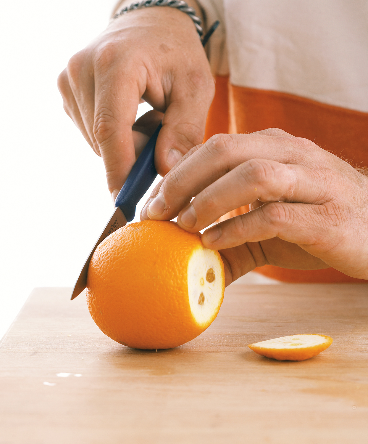 trimming ends from whole orange