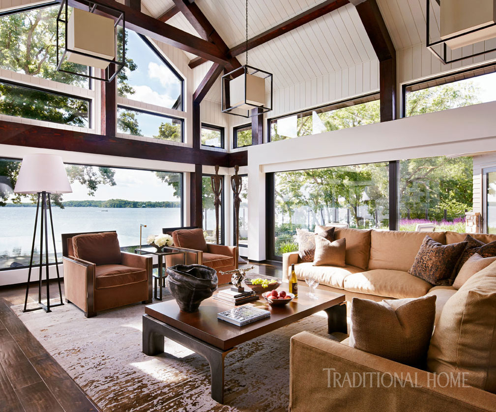 comfortable living room with vaulted ceilings and geometric pendants