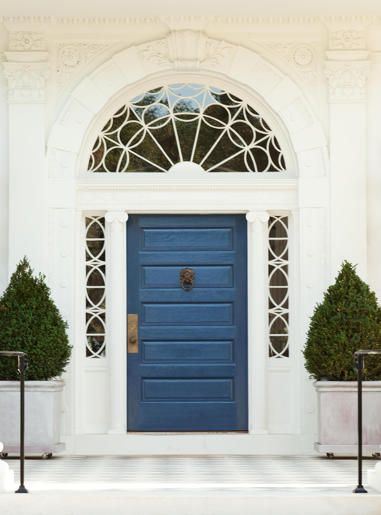 view to classical doorway and blue painted doors