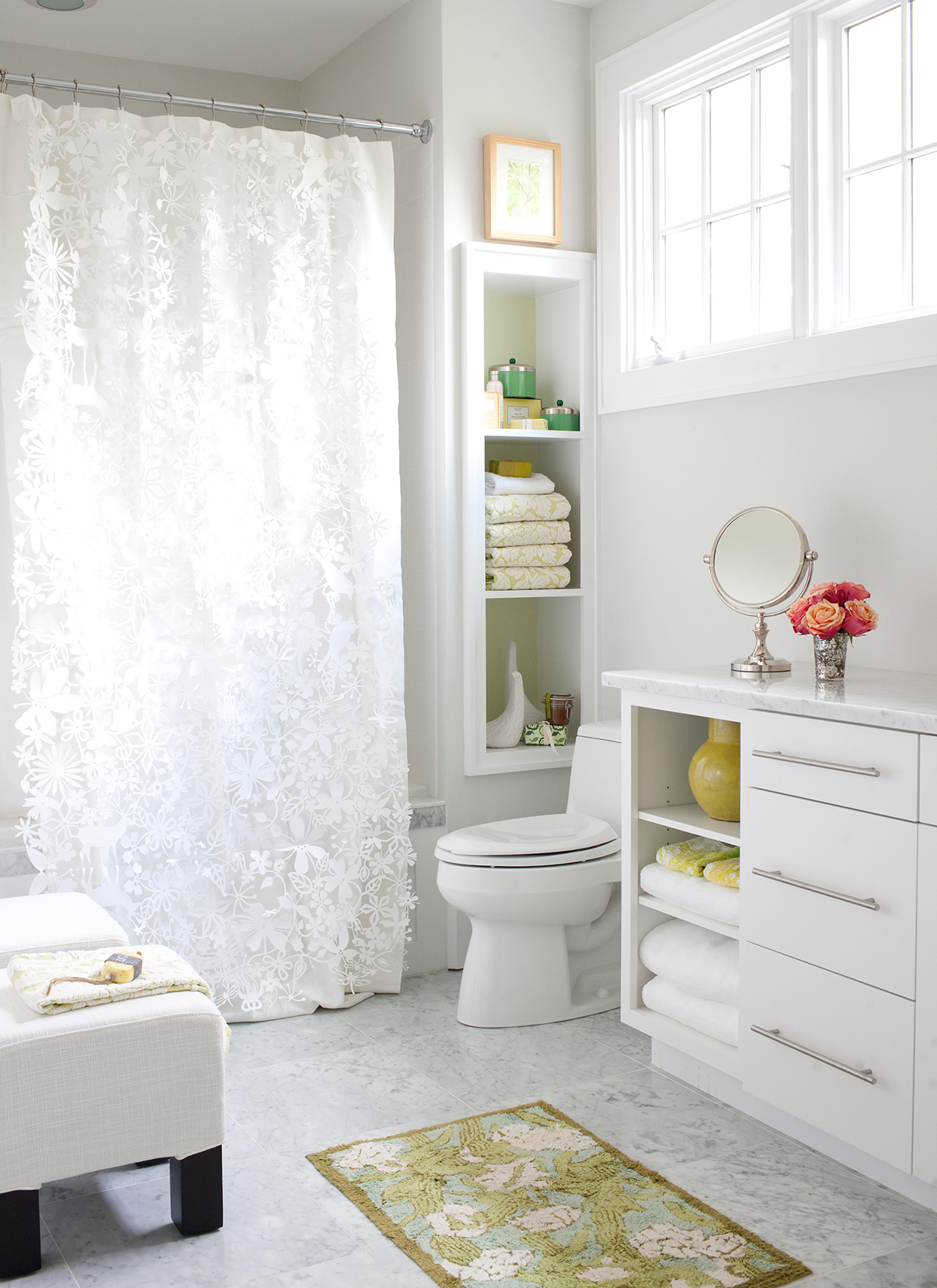 white bathroom with floral and yellow-green accents