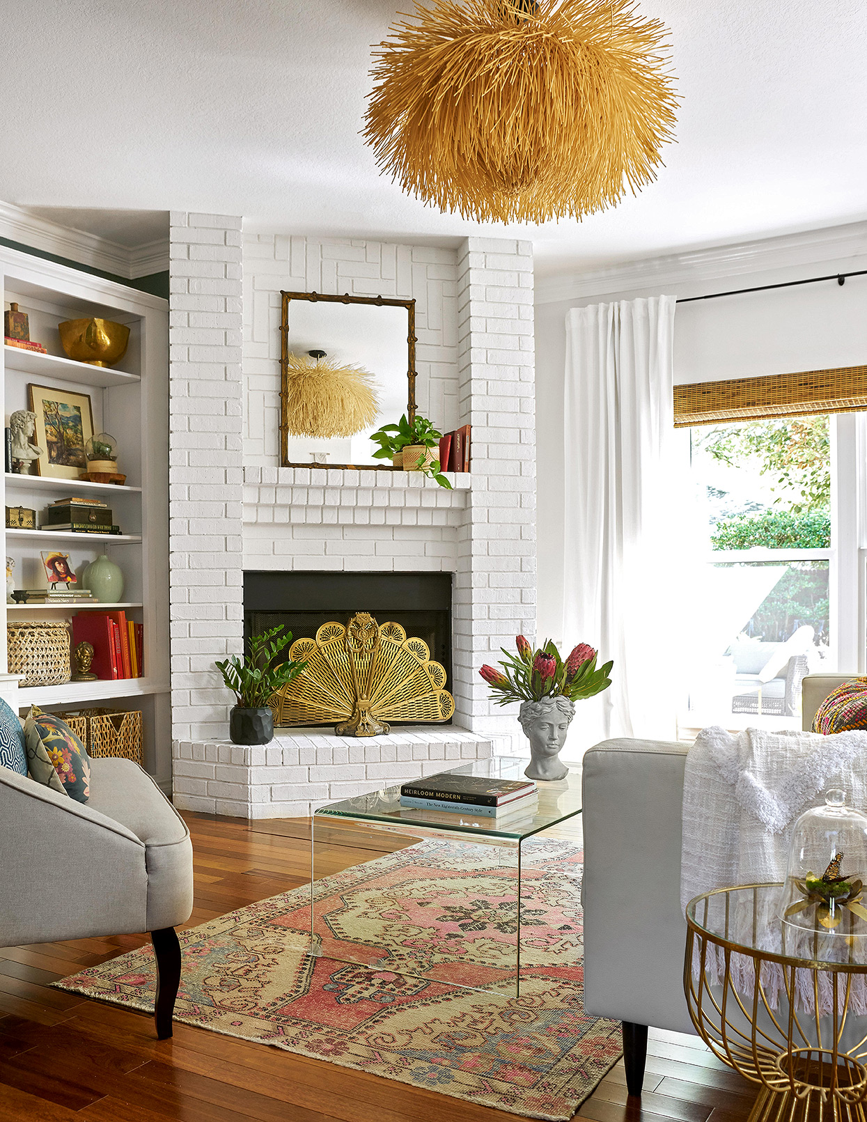 bright retro living room with painted brick corner fireplace