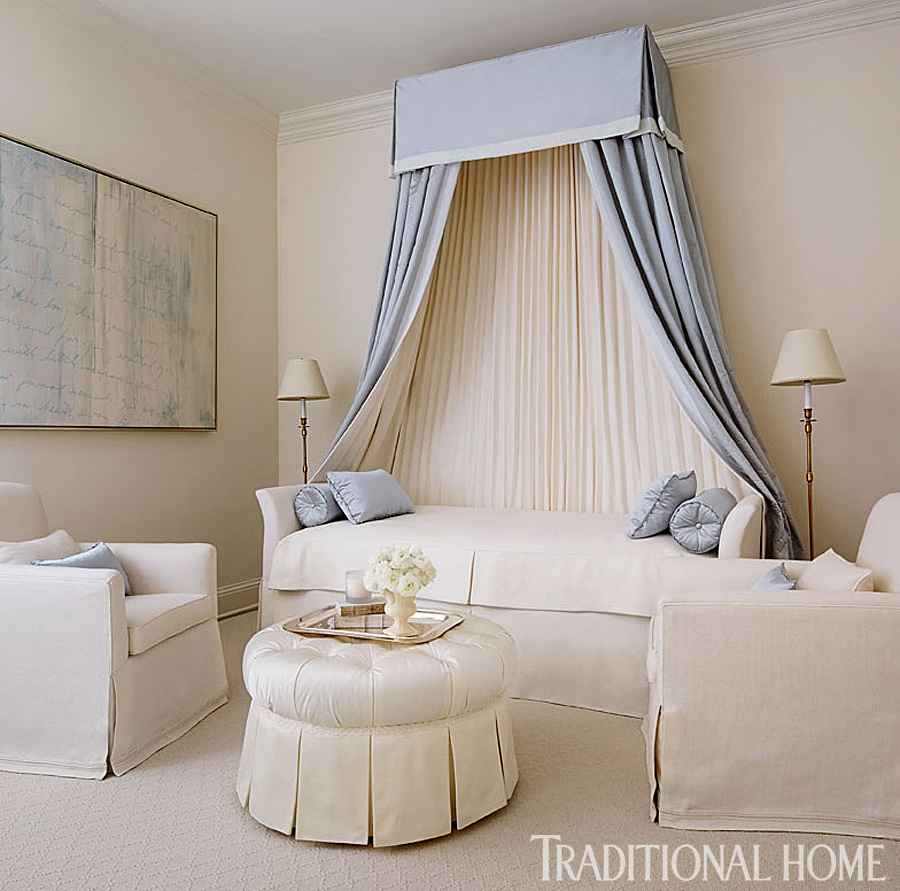 white daybed with blue canopy