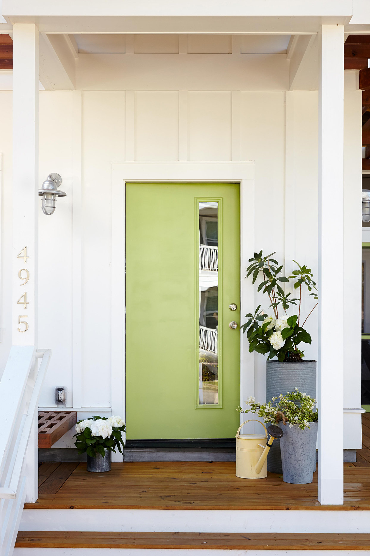 white exterior with green door